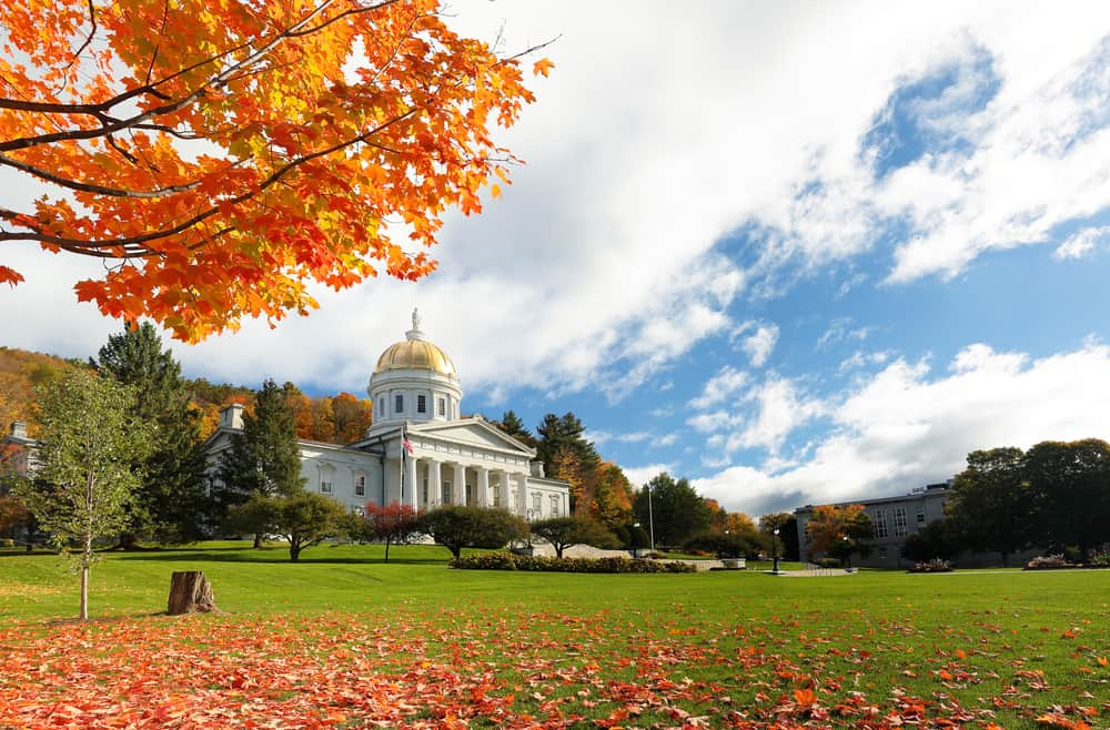 Gold topped capitol building surrounded by fall foliage, most beautiful places in vermont