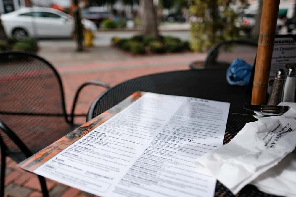 image of a menu sitting on an outside table