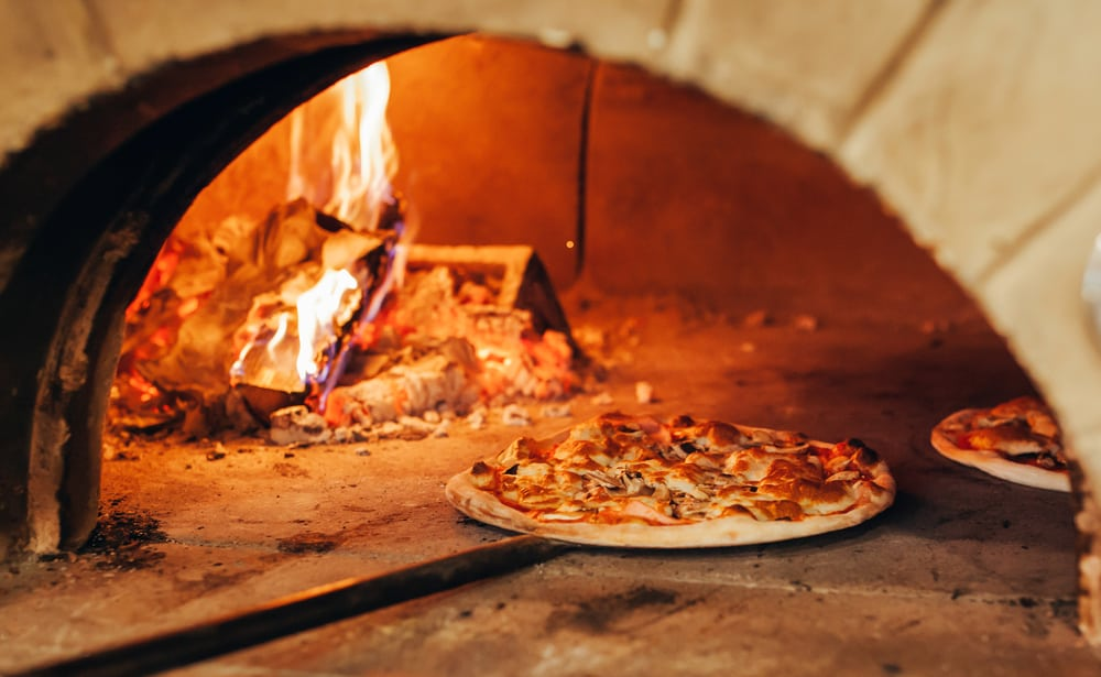 pizza inside a wood fired oven
