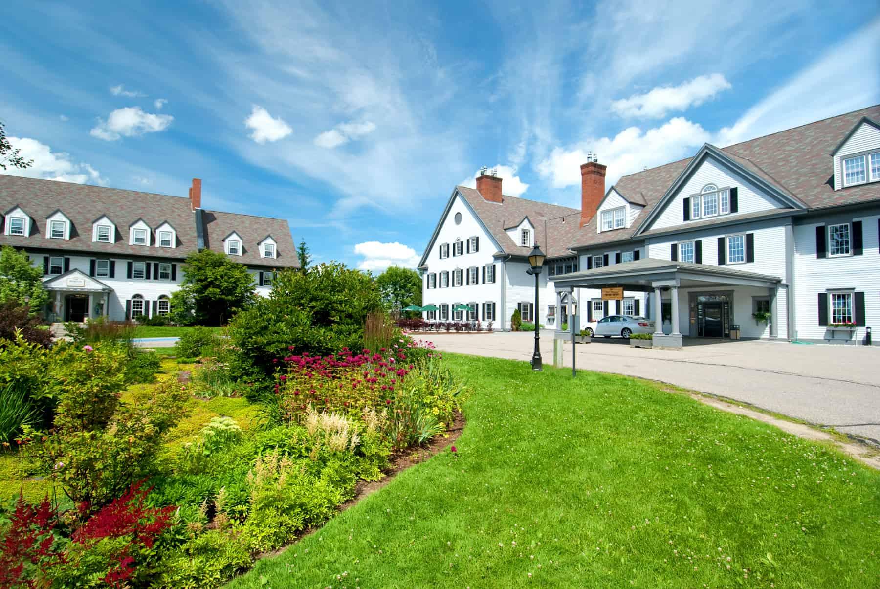 White lodging building under a blue sky, best Vermont hotels