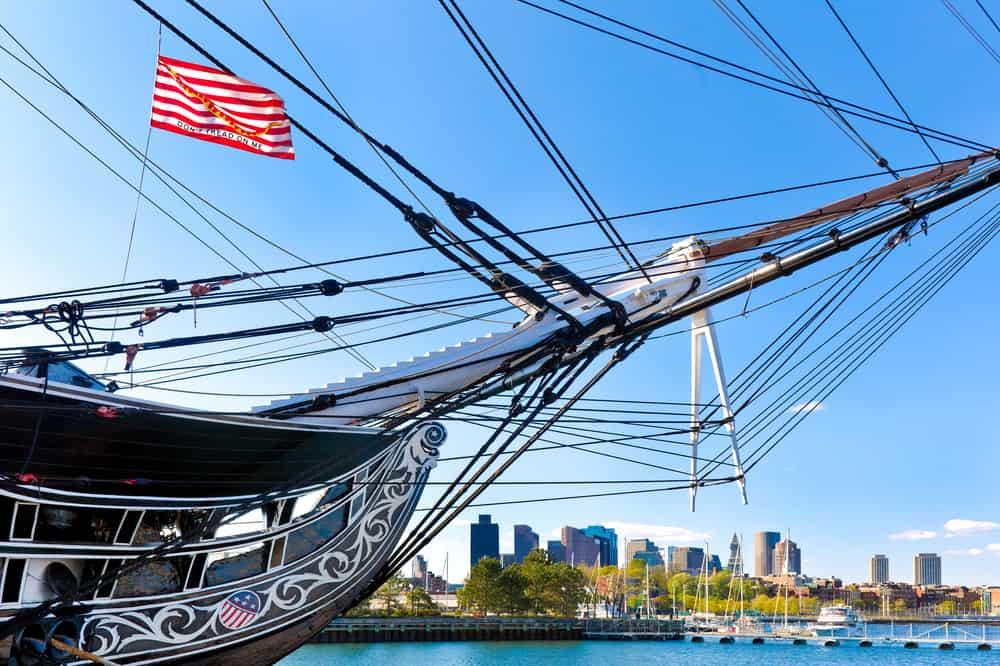 Boston skyline framed by the USS Constitution, oldest battleship in American history