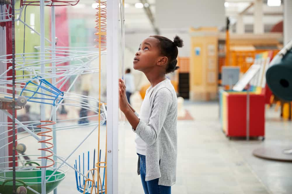 Girl looking at an exhibit in a science museum
