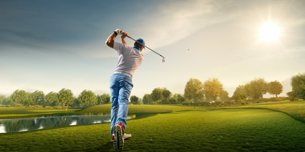 Man swinging at a golf course