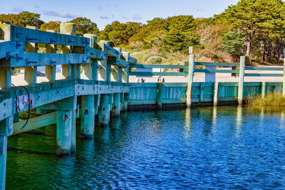 Old wooden bridge crossing the water