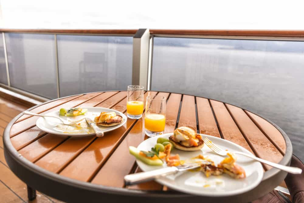 Plates of brunch sitting on a table on a cruise