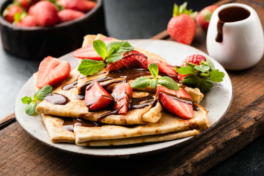 Stack of chocolate and strawberry crepes on a plate, restaurants in portsmouth