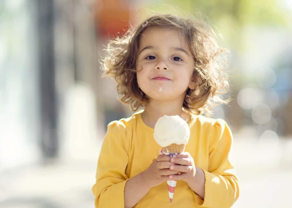 Little girl eating an ice cream cone