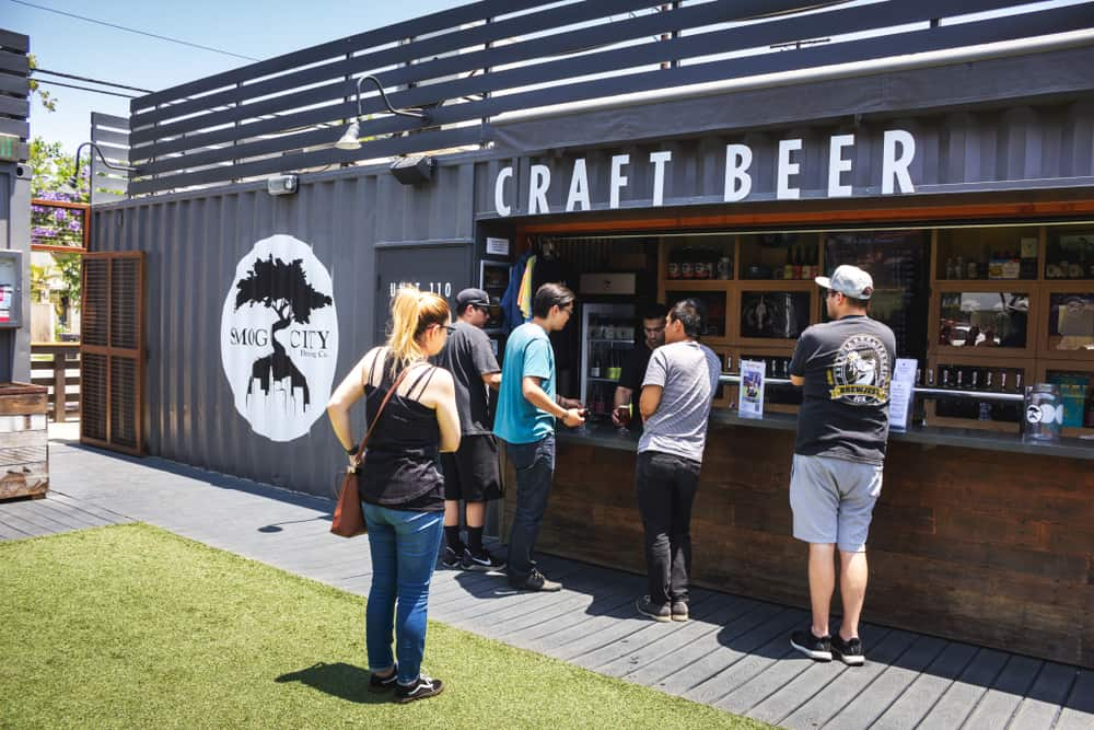 People standing in line at a craft beer stand