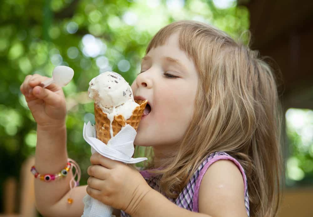 Girl licking an ice cream cone