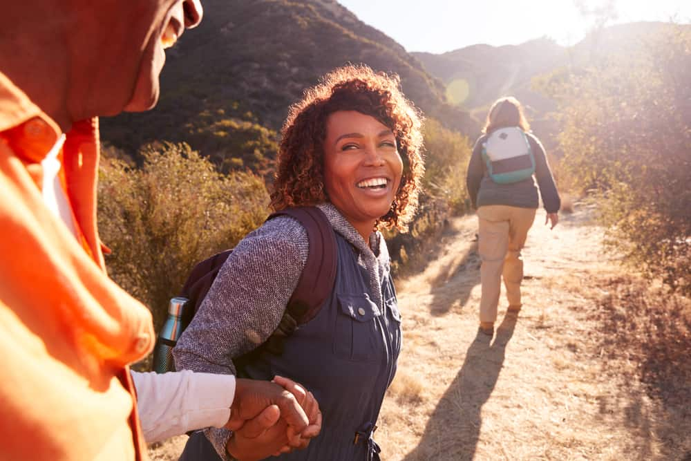 People hiking and holding hands