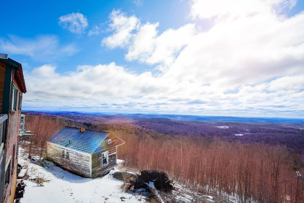 View from the top of hogback mountain under a blue sky in the winter