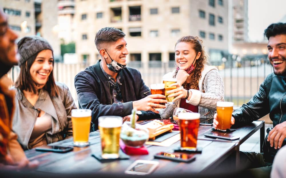 Friends clinking glasses while drinking beer