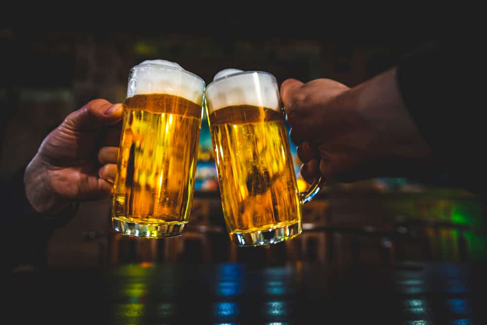 People clinking beer glasses