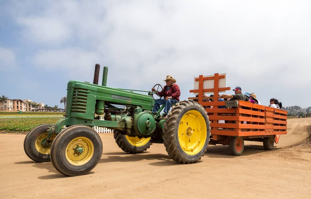 Tractor pulling a group of people on a hay ride