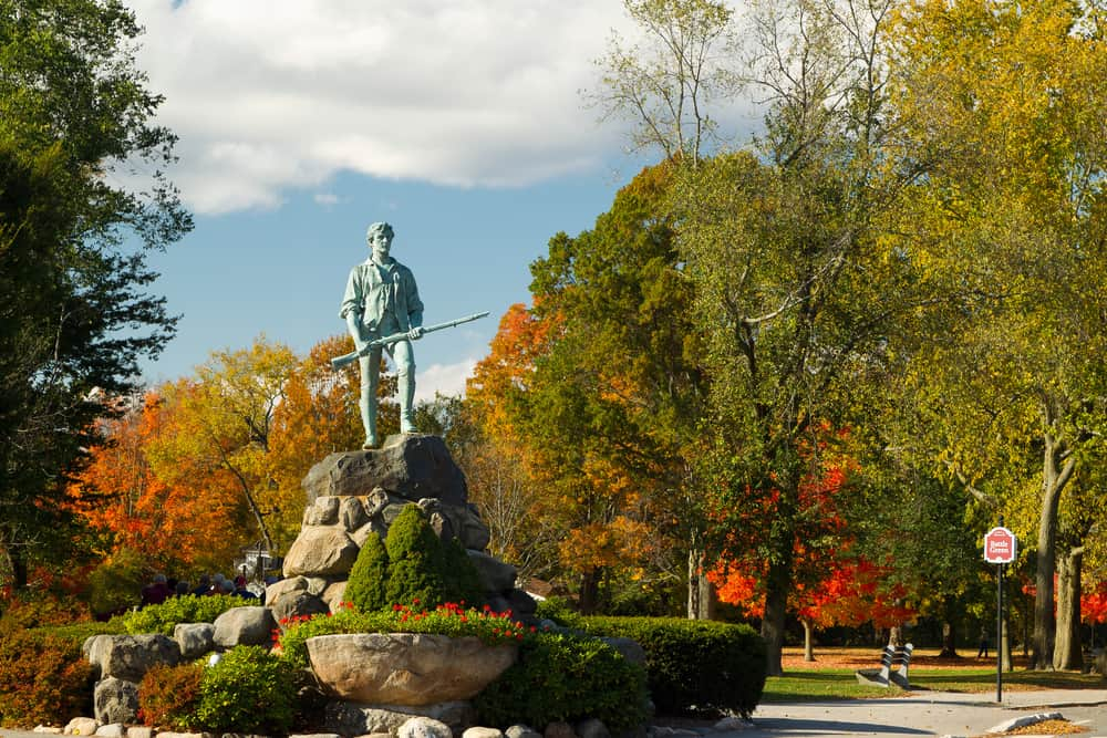 Statue on a pedestal in autumn
