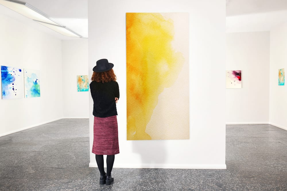 Girl looking at art on the wall in an art gallery