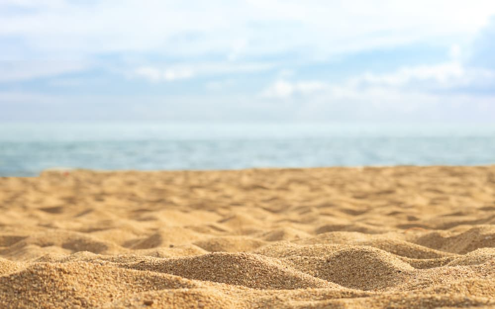 Sand with a beach in the background
