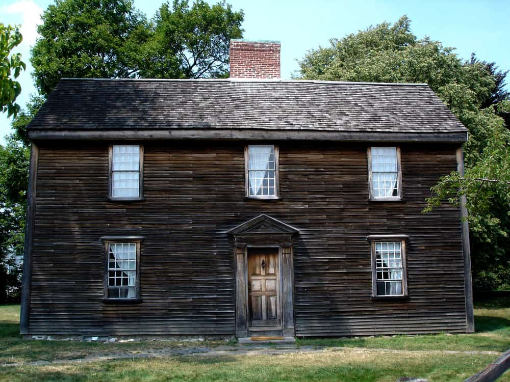 Historic wooden building with five windows