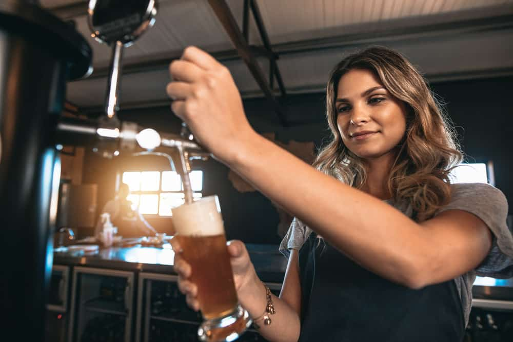 Girl pouring a pint of beer