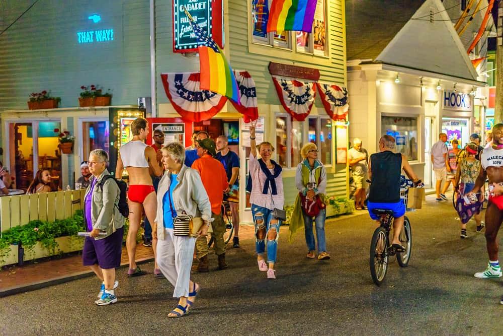 People walking down the street in Provincetown having fun