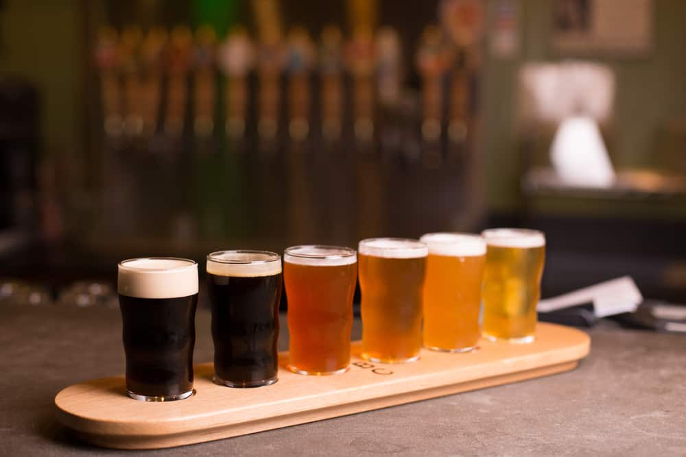 Flight of beers from dark to light on a table