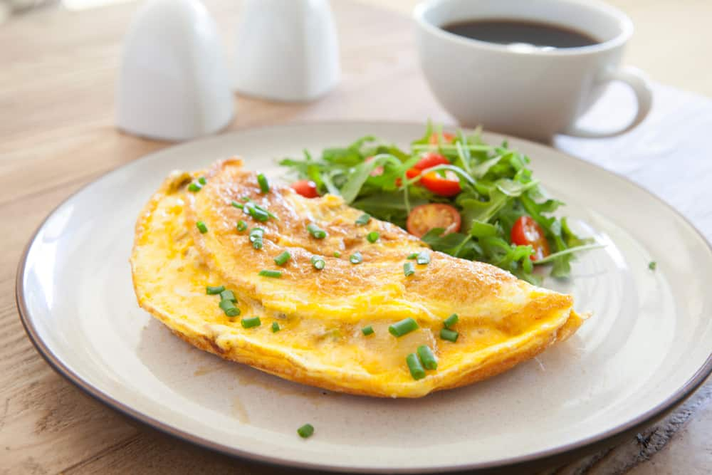 Omelet on a plate with a green salad