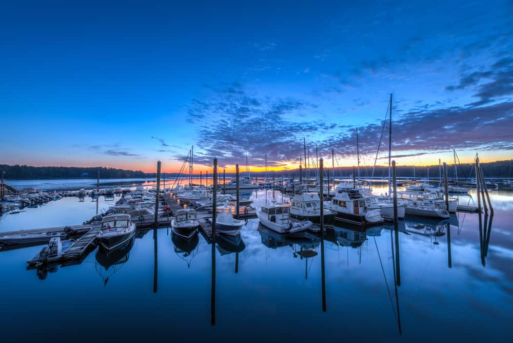 boats sitting on the water at sunset