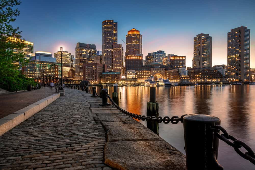 boston city skyline at night along the harbor walk - best things to do in boston bucket list