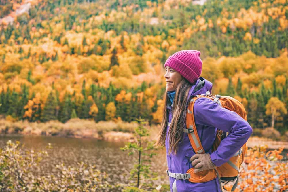 Woman with a backpack hiking in the fall